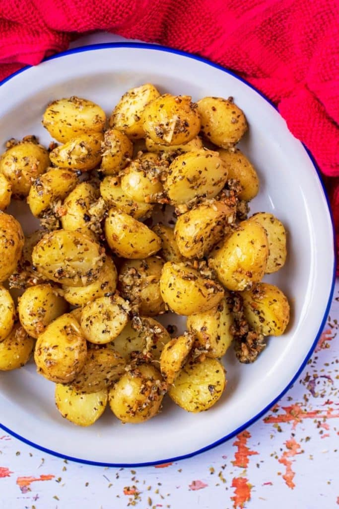 Italian Parmesan Roasted Potatoes in a bowl on a wodden surface