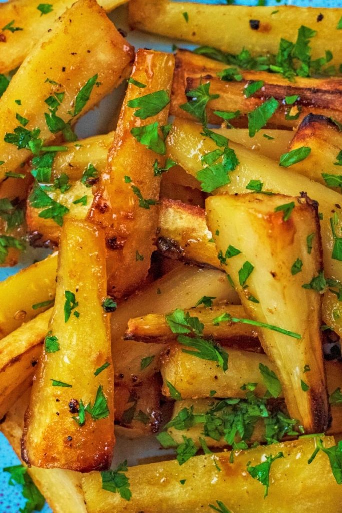 Mustard and Honey Roasted Parsnips with chopped parsley on top