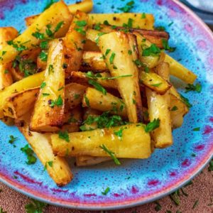 Mustard and Honey Roasted Parsnips on a blue plate