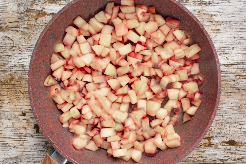 A frying pan with cooked, chopped apples