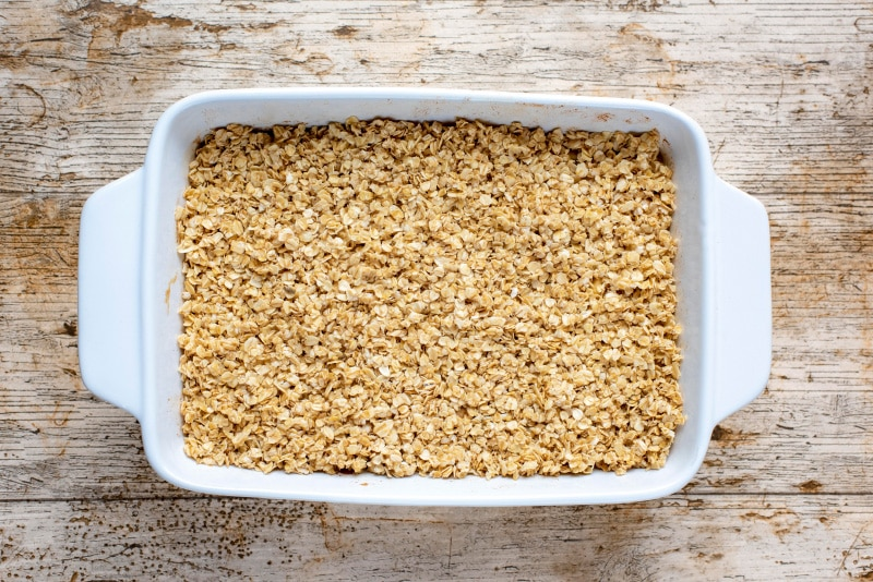 Oaty apple crumble in a white baking dish