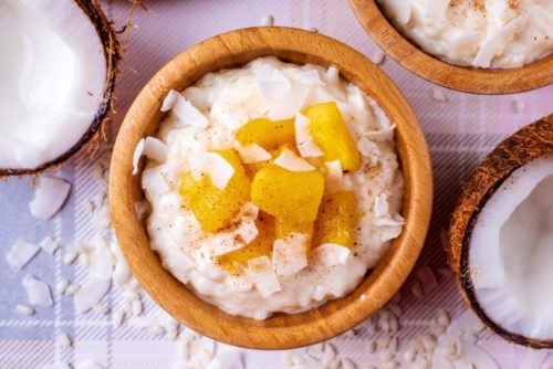 Coconut rice pudding in a bowl with pineapple on top