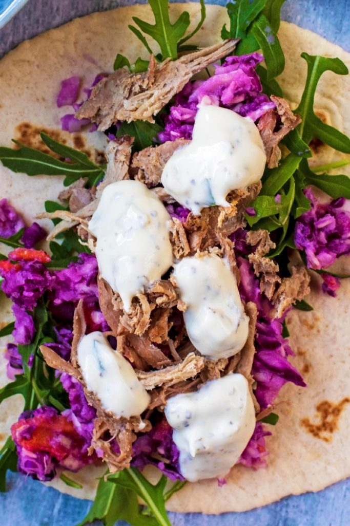 Pulled lamb with slaw and dollops of tzatziki