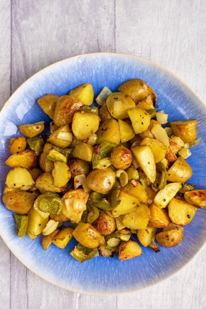 Baked Home Fries on a blue plate