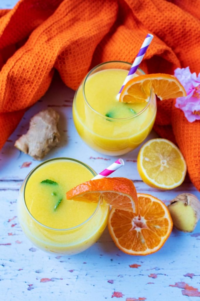 Immune Booster Juice in two glasses next to an orange coloured towel