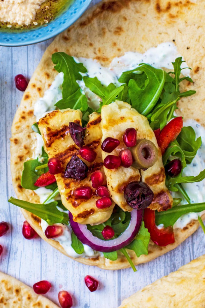 Grilled Halloumi on a bed of lettuce and peppers all on a flatbread