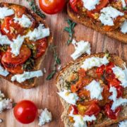 Roasted Cherry Tomatoes and mozzarella on toasted bread
