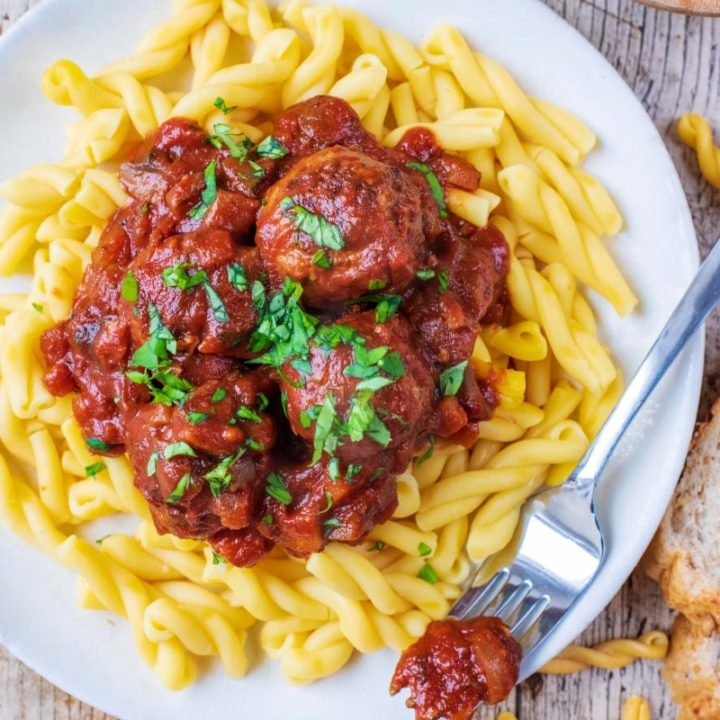 Slow Cooker Meatballs on a plate with a fork