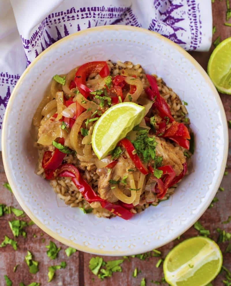 Slow Cooker Thai Chicken Curry in a white bowl with a lime wedge on top