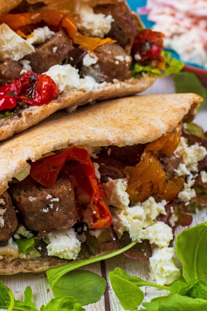 Two pitas filled with meat and vegetables