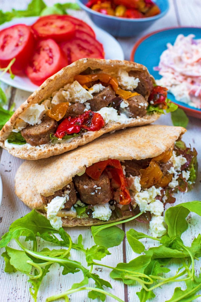 Pita breads stuffed with lamb kofta, vegetables and cheese