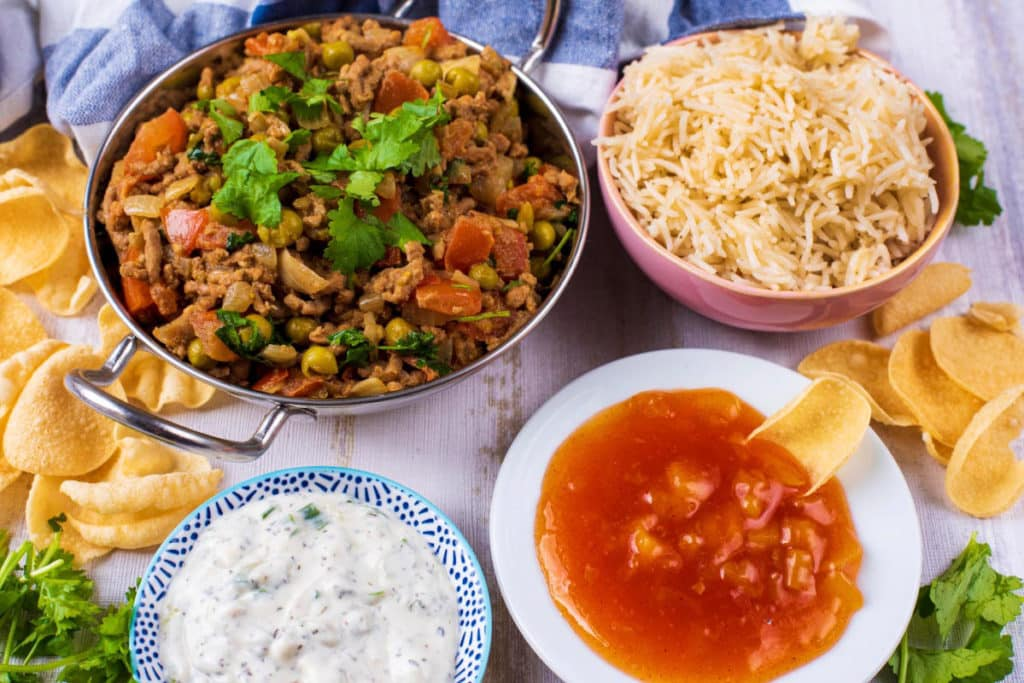 Minced lamb curry with brown rice, and sauces