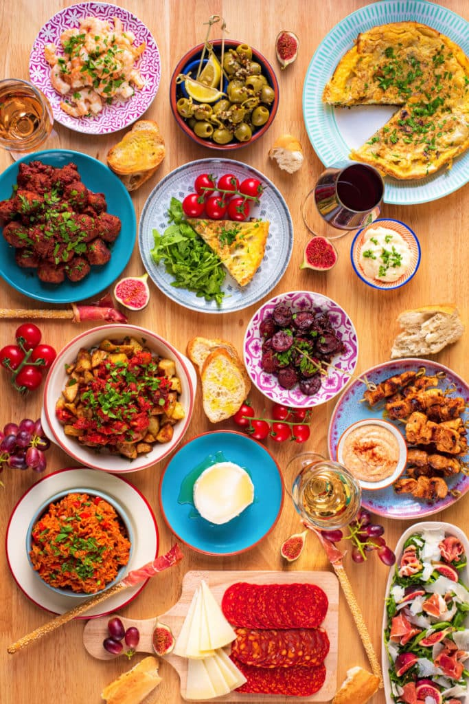 A table coveres in various tapas dishes