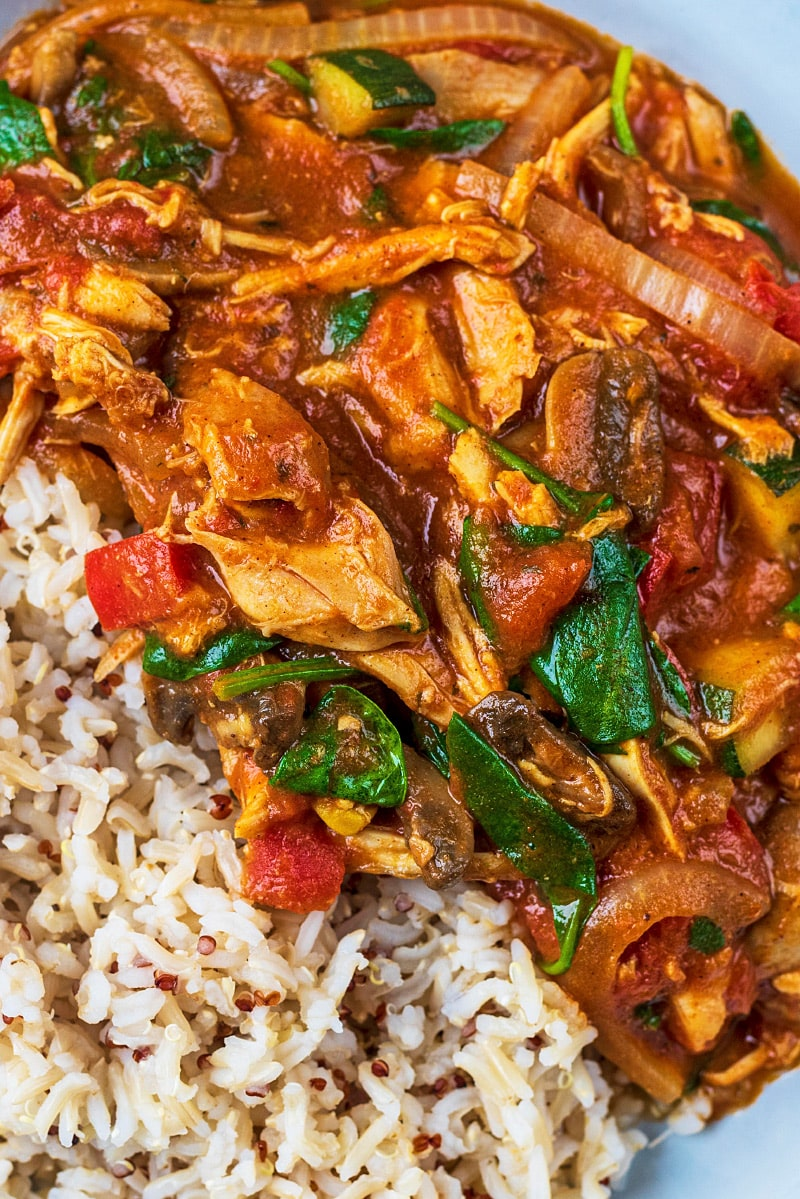 Turkey curry and rice with spinach and vegetables