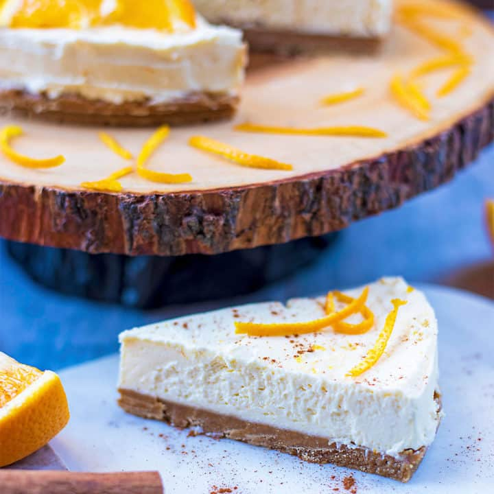 A slice of Christmas cheesecake topped with orange peel
