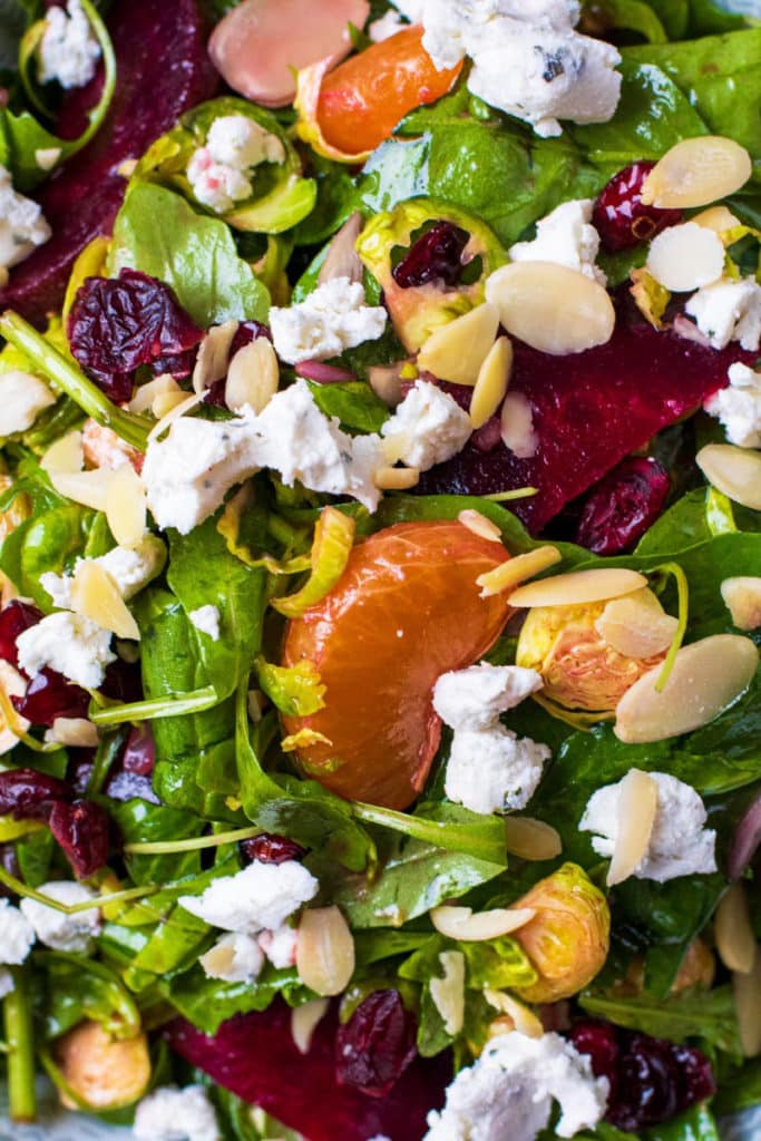 Salad leaves topped with clementines, beetroot, goats cheese, almonds and cranberries