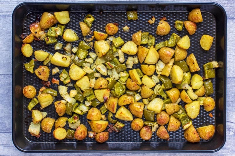 A baking tray covered in baked home fries