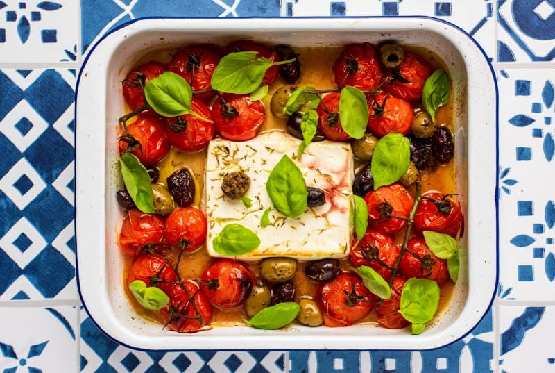 Feta, olives and tomatoes in a baking tray
