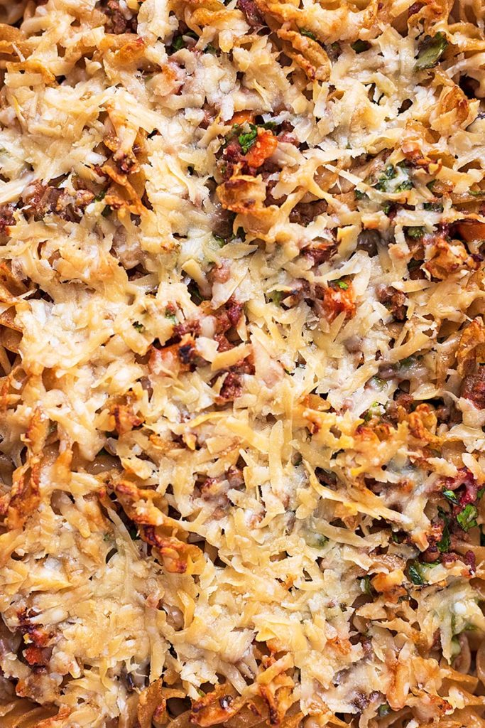 Grateed cheese covering a pasta bake