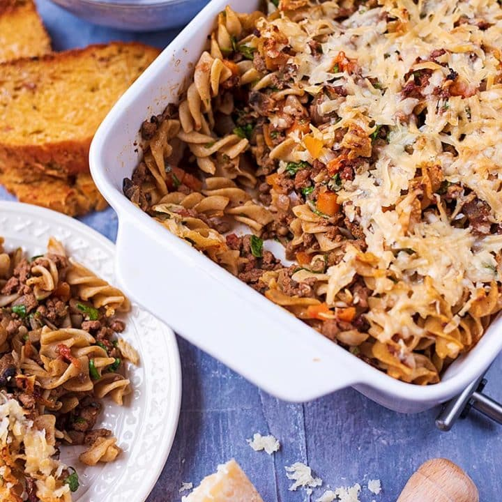 Bolognese Pasta Bake on a plate and in a baking dish