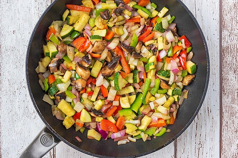 A frying pan full of chopped vegetables