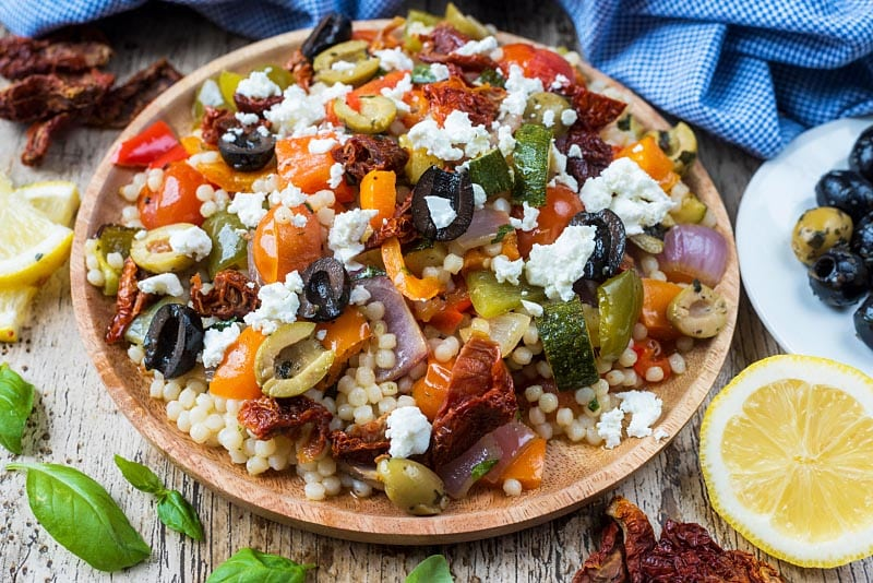 Couscous salad topped with olives and feta