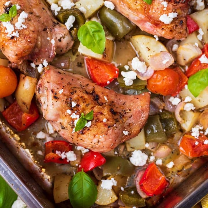 Chicken Tray Bake containing chicken thighs and roasted vegetables