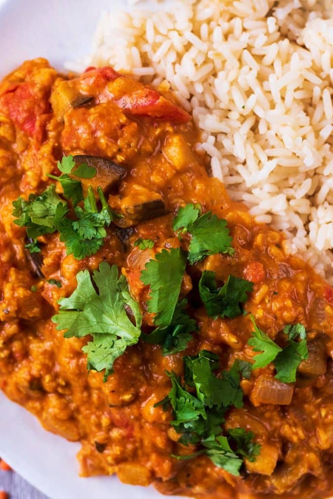 A lentil curry with chopped cilantro sprinkled on top of it
