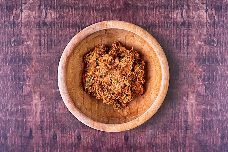 Curry paste in a small wooden bowl