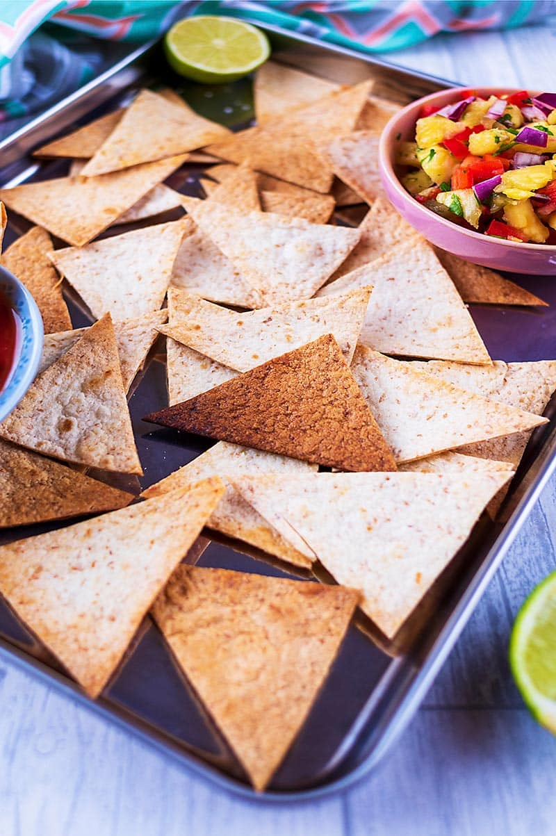 A steel tray covered in tortilla chips