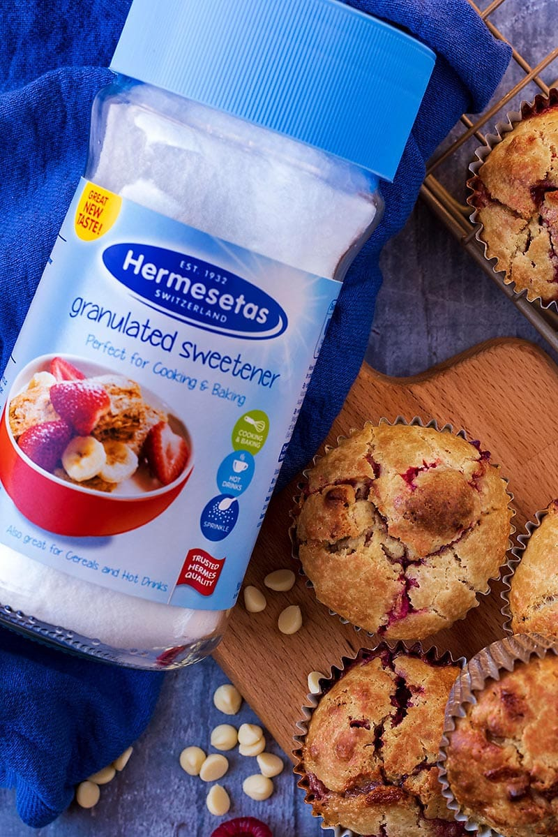 A jar of hermesetas sweetener next to some muffins
