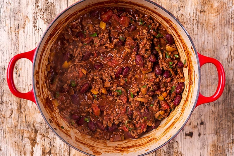 A large red pot full of chilli con carne
