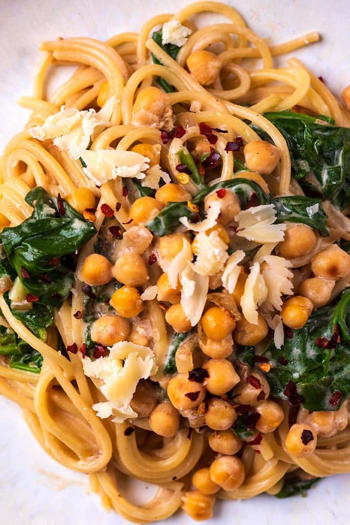 chickpeas and spinach in a creamy sauce mixed with spaghetti