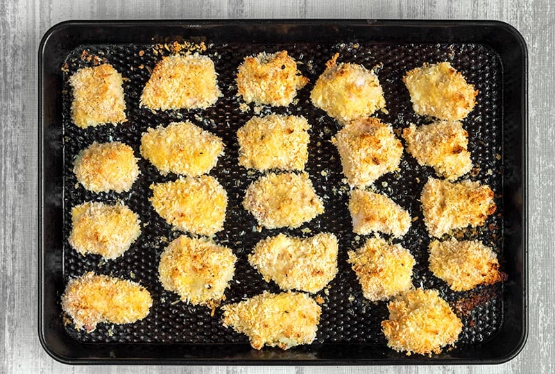 Cooked Parmesan Chicken Bites on a baking tray.