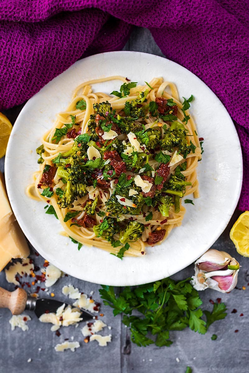 A pasta dish containing broccoli, tomatoes and cheese