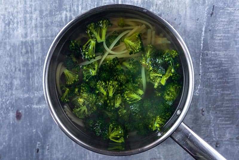 Broccoli and pasta boiling in a pan