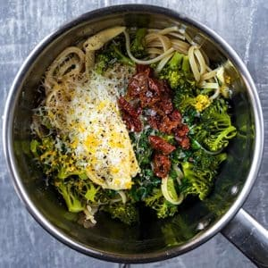 Pasta, broccoli, chopped tomatoes, cream, lemon zest and seasoning all in a stainless steel pan