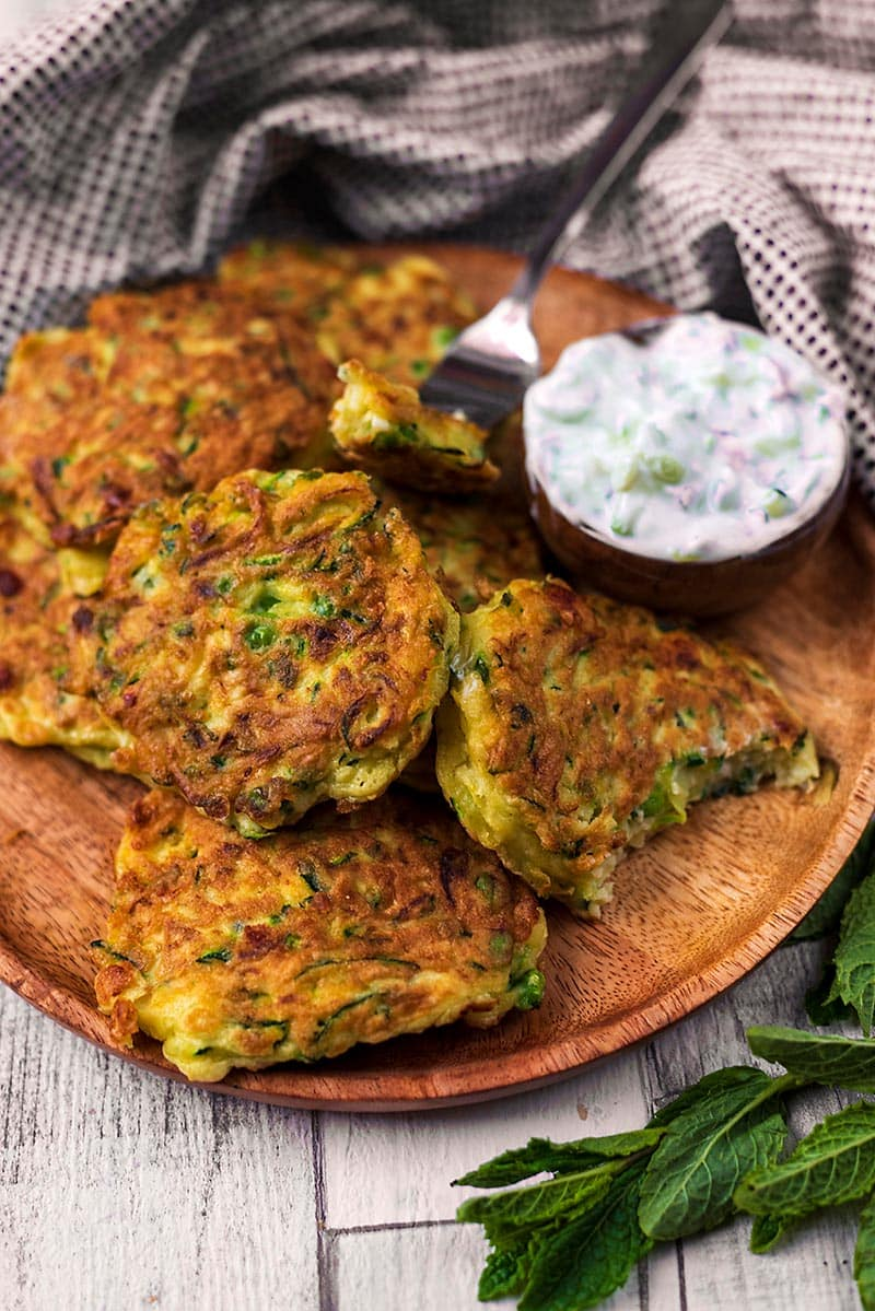Courgette fritters with a fork cutting a peice off