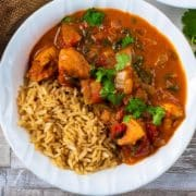 Easy Slow Cooker Chicken Curry in a bowl with some brown rice