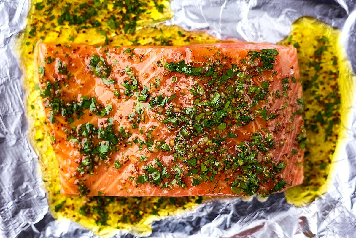 A large side of raw salmon covered in a honey and mustard coating