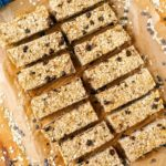 Fourteen healthy flapjacks on a sheet of parchment paper.
